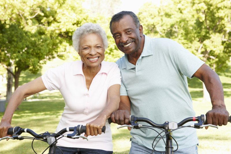 Couple smiling with dental implants in Arlington